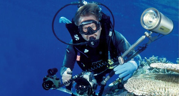 Helmut Debelius with his underwater cameras on a reef in the South Seas state of Tuvalu, north of Fiji, in 2001.