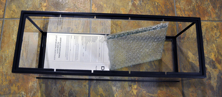 Instructions / Warranty information, along with the glass dividers, are found inside the aquarium once the inner bubble wrap is removed.