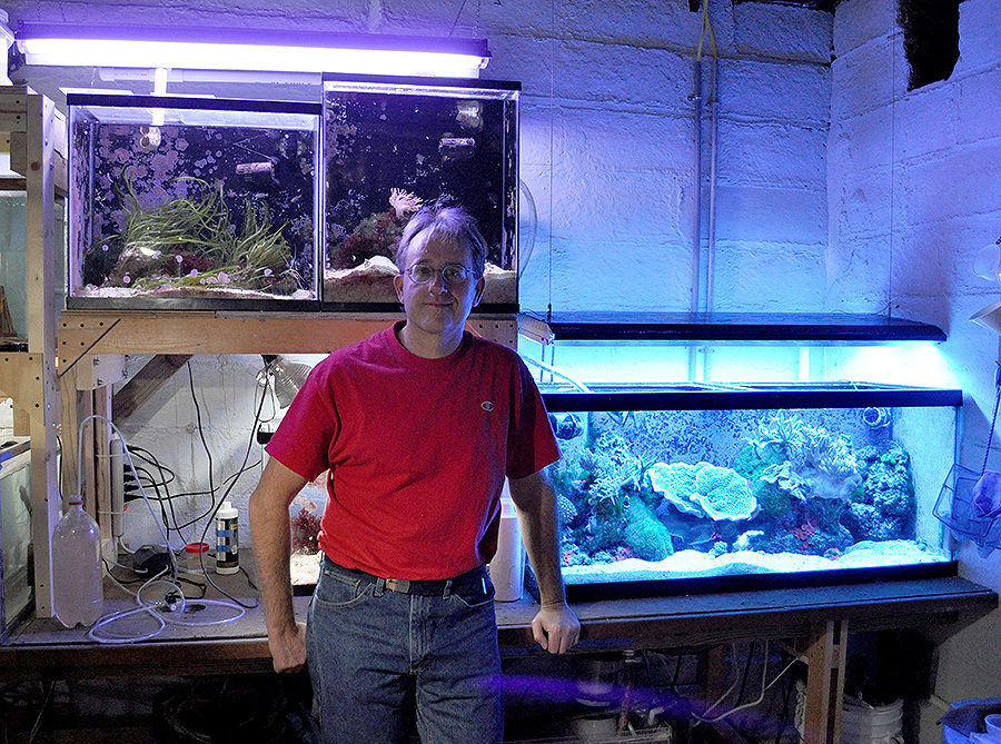 Aquarist and first time CORAL Magazine contributor David Watson, DVM, at home in his fishroom, November 2012.