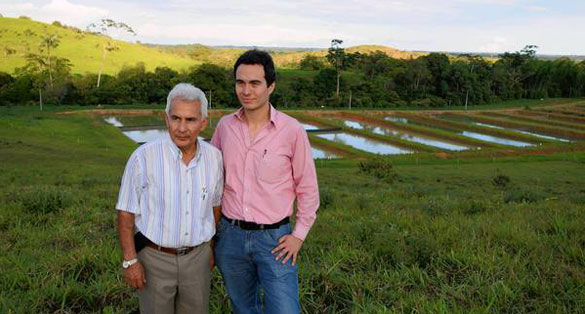 New Silver Arowana farm in Florencia, Colombia, with AIT President Alvaro Marles, left, and Vice President Carlos Ramirez, who hope to ship 20,000 fish to Asia this year. Image: Chris Kraul/LA Times.
