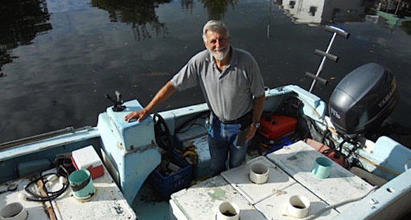 Feddern with his collection boat docked near his Key Largo home and holding facilities.