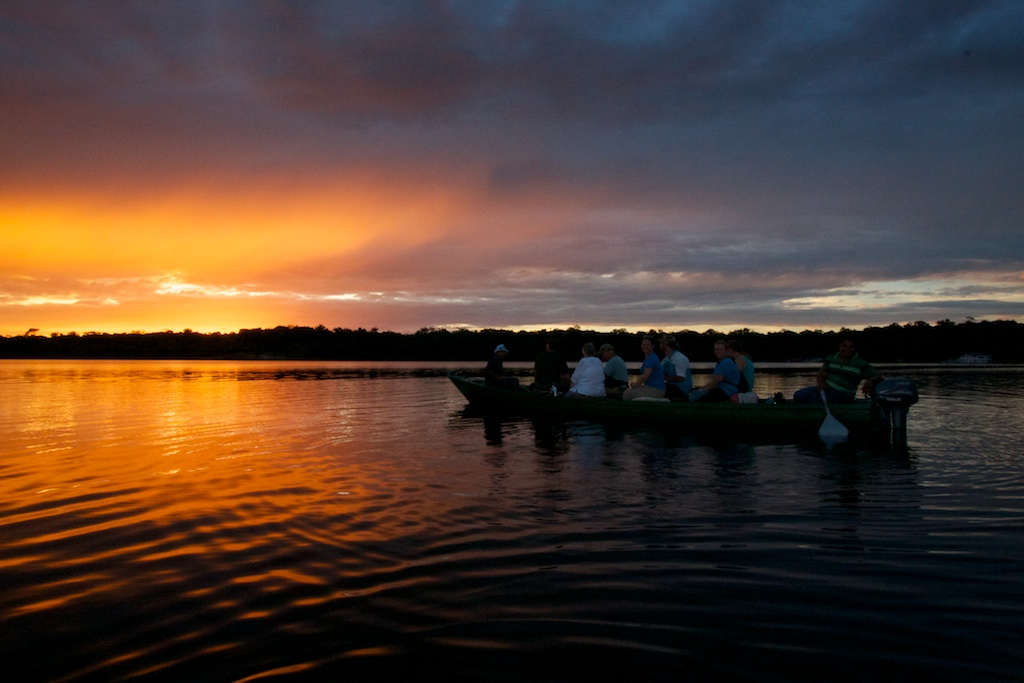 A motor canoe at sunset on the Rio Negro.