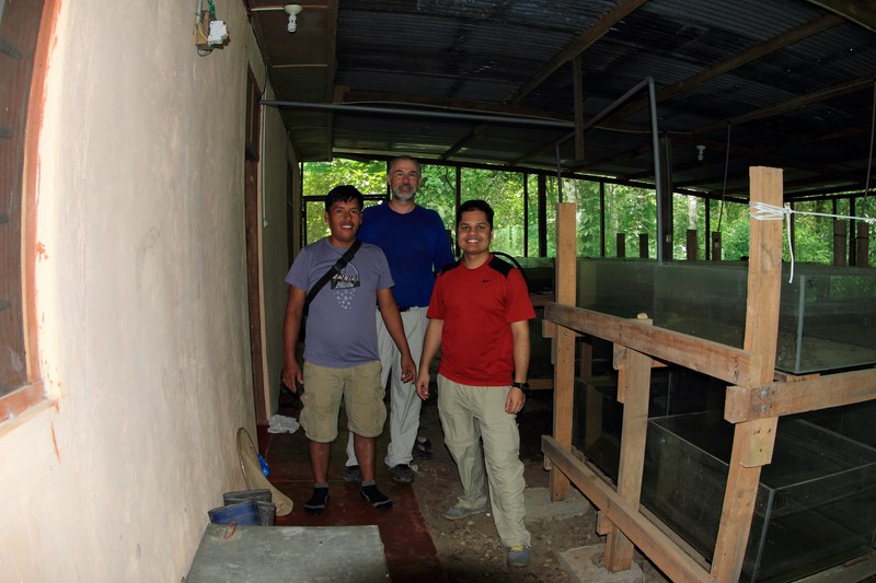 L to R: Felix (a local guide), Brian and I, in Brian's fishroom where he keeps all the collected fish
