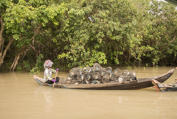 A fisherwoman setting traps on the lake