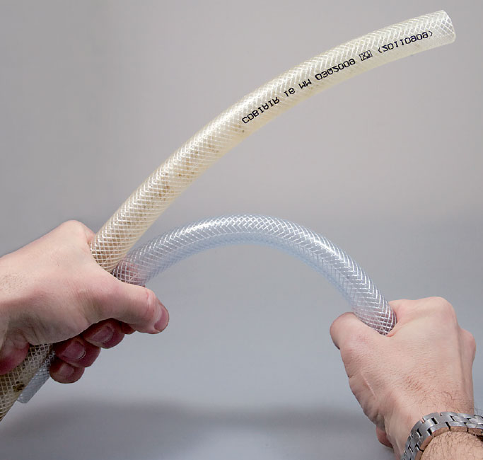 Hoses made of PVC: new (bottom) and after one year in a salt water tank (top). As the plasticizers are released, flexibility is lost and the material becomes hard and brittle.