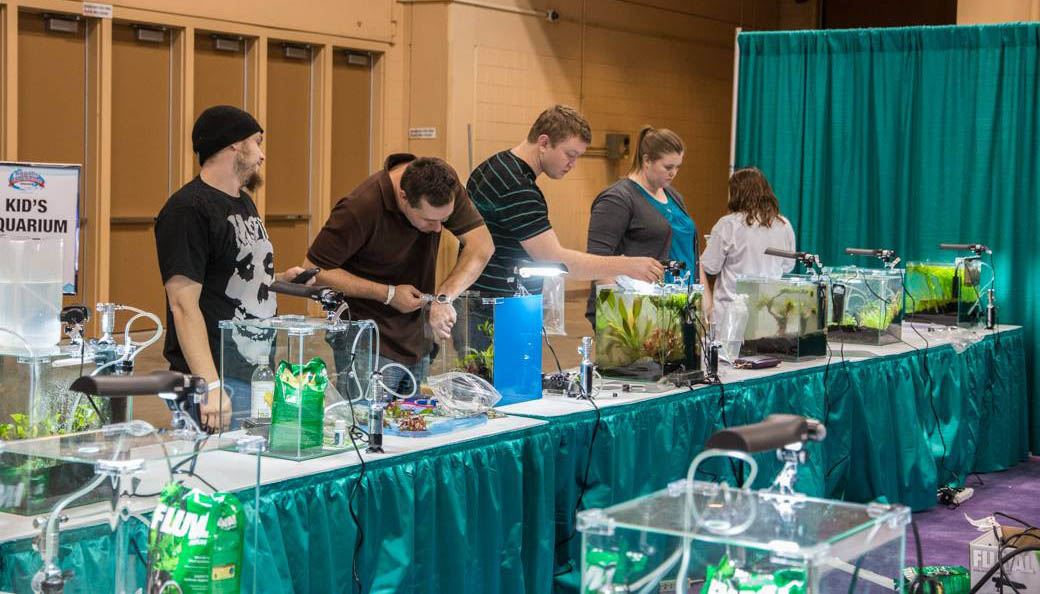 Aquascapers working fast to complete their entries for the 2014 Aquascaping Live! competition.