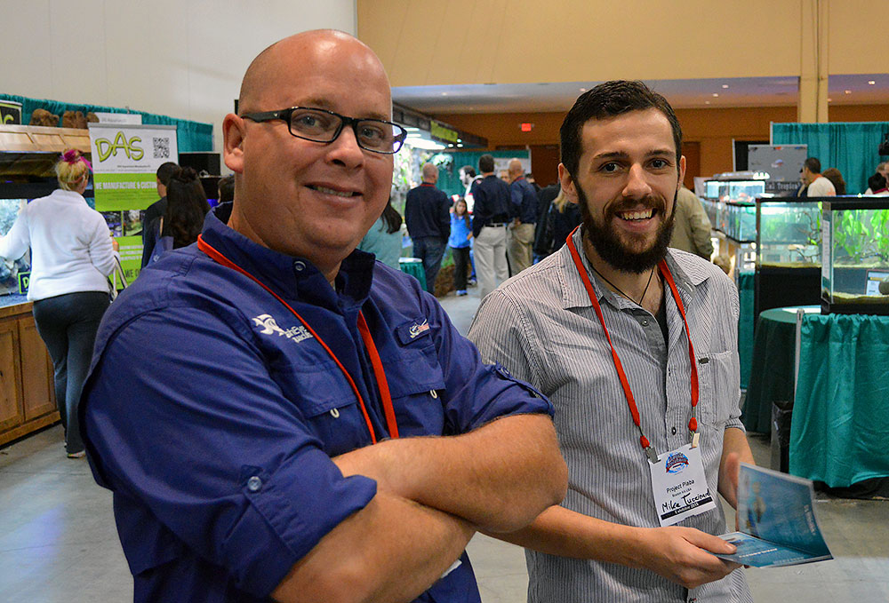 Jonathan Foster of FishEye Aquaculture (left) and AMAZONAS Sr. Editor Mike Tuccinardi talking shop at the FTFFA booth.