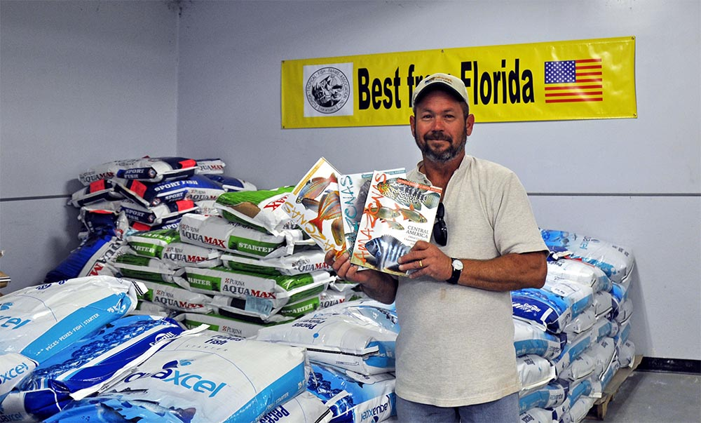 Fish farmer Morris Little shows off AMAZONAS Magazine at the FTFFA Co-op Shop. Yes, America's Tropical Fish Farmers read AMAZONAS! Image courtesy Jonathan Foster.