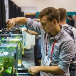 Competitors at work during the Aquascaping Live! Contest at Aquatic Experience - Chicago 2015. Image by Dan Woudenberg