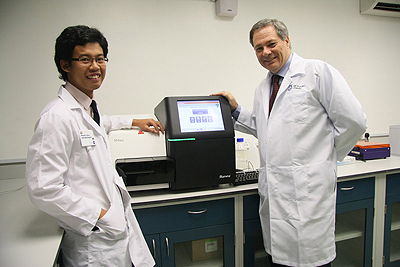 Dr. Gan Han Ming with Prof. Chris Austin with one of two new Monash University of two state-of-the-art DNA sequencing systems that will open the doors to studying many other Malaysian fish species.
