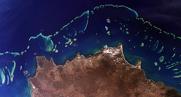 Section of Australia's Great Barrier Reef, one of many reefs that CORAL will study beginning this year. Credits: NASA