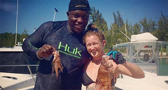 Pro football player appears outfished by Rachel Bowman in a dock scene in the Keys. Source: Lionfish Huntress.