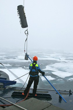 Testing summer polar waters in the Svalberg Sea. Ice cover is vanishing in many areas. Image: SWERUS