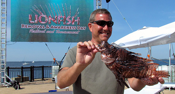 Charles Mayling with largest lionfish ever caught in the Gulf: 44.5 cm (17.5 inches). Image; Alicia Wellman.
