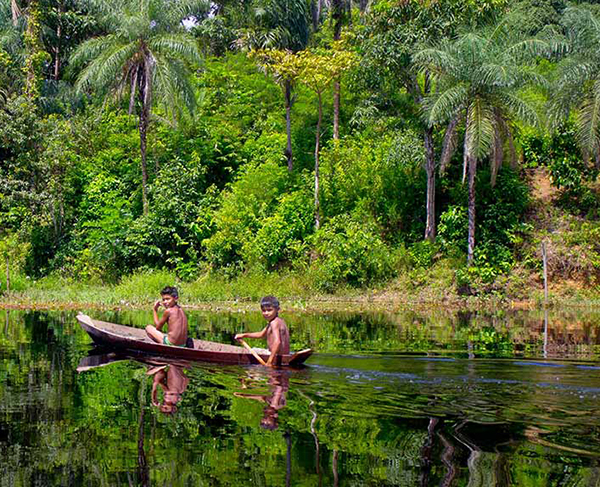 Mundukuru boys in dugout canoe on the Rio Tapajos. Image: AmazonWatch