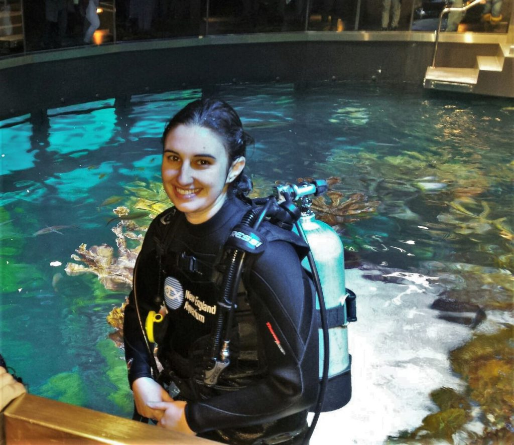 "Graduate MASNA scholarship winner, Liz, at New England Aquarium, Spring 2015 Giant Ocean Tank (GOT) Internship. She states ""[I] couldn't be happier after a successful maintenance dive in the GOT."""