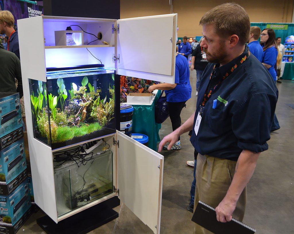 Aquarium Adventure's Dave Drake opens up the Kithros cabinetry to reveal the inner workings of the setup.