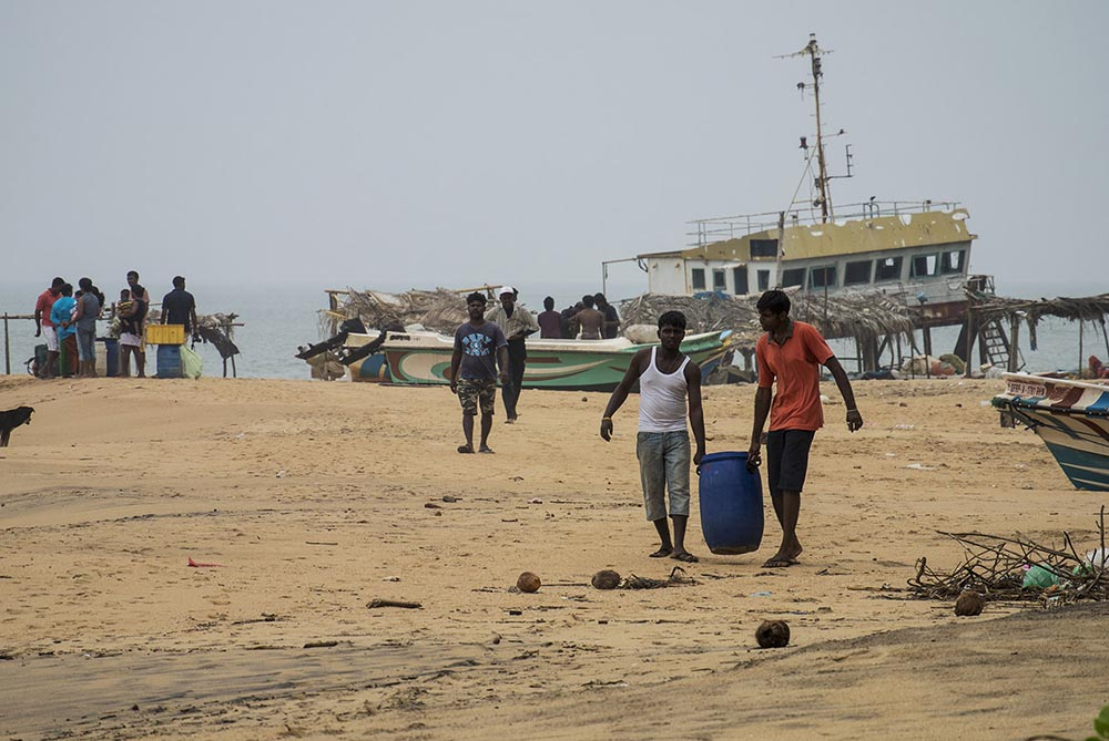 Sri Lankan marine fish collectors returning from a dive. This trade continues to be an important livelihood in coastal communities
