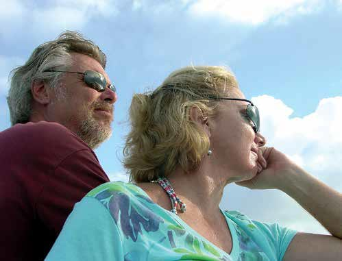 Walt and Deb Smith on a boat en route to one of their mariculture coral nurseries off the island of Lautoka, Fiji.