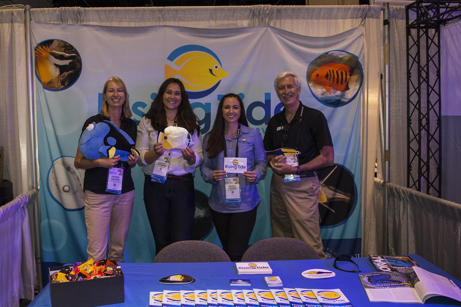 The crew from =Rising Tide Conservation manning their booth and promoting their groundbreaking work with marine aquarium fish breeding and rearing.