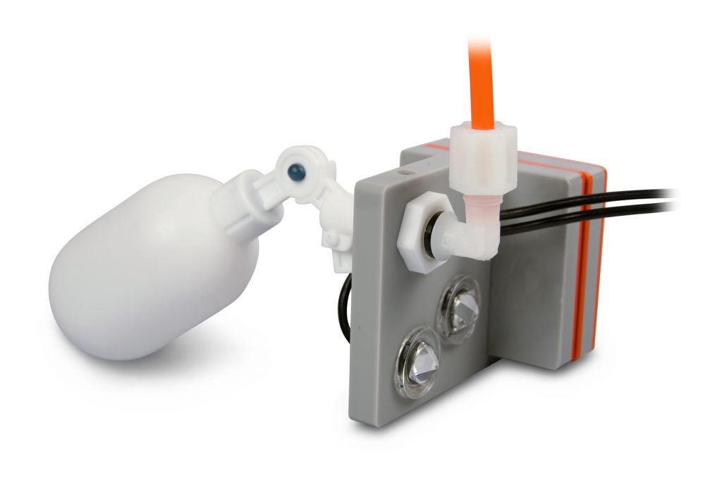 The business end of The ATK: two optical sensors plus a magnetically-mounted float switch for fail-safe redundancy.