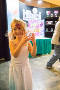 Kid's face painting at Aquatic Experience - Chicago 2016. Image by Dan Woudenberg/LuCorp Marketing for the World Pet Association.