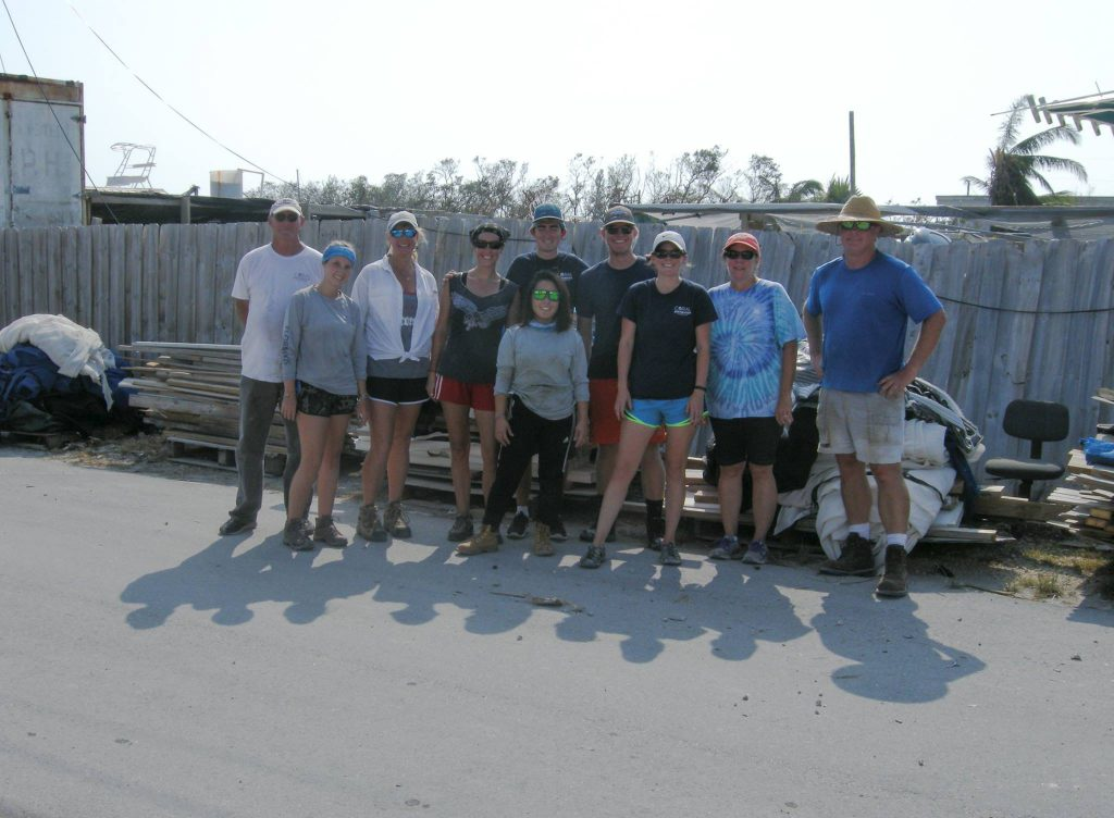 Bill Backus (at far right) and his daughter Mari (2nd in from left) who managed the Marathon coral farm, are joined by staff and volunteers from the Coral Restoration Foundation in the clean-up effort.