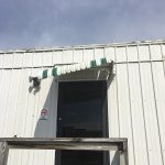 Minor wind damage to an awning at Segrest Farms.