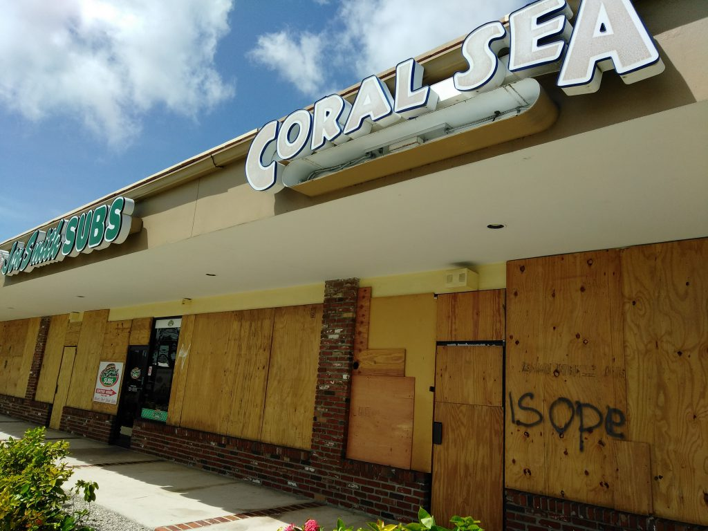 Local fish shop Coral Sea Aquarium in West Palm Beach, FL, bordered up, where brand new owner James Wood camped out for days in the aftermath of Hurricane Irma. Learn more about their story at the end of Part II of our three part series. Image Credit: Coral Sea Aquarium