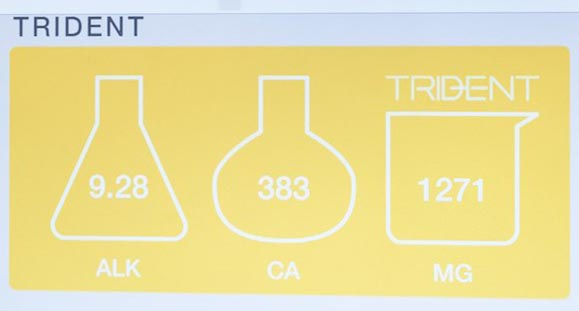 "The ""holy trinity"" of reef aquarium water chemistry parameters; alkalinity (dKH), calcium (ppm), and magnesium (ppm) levels are shown on a digital display at the Neptune Systems' MACNA booth. Image courtesy Neptune Systems."