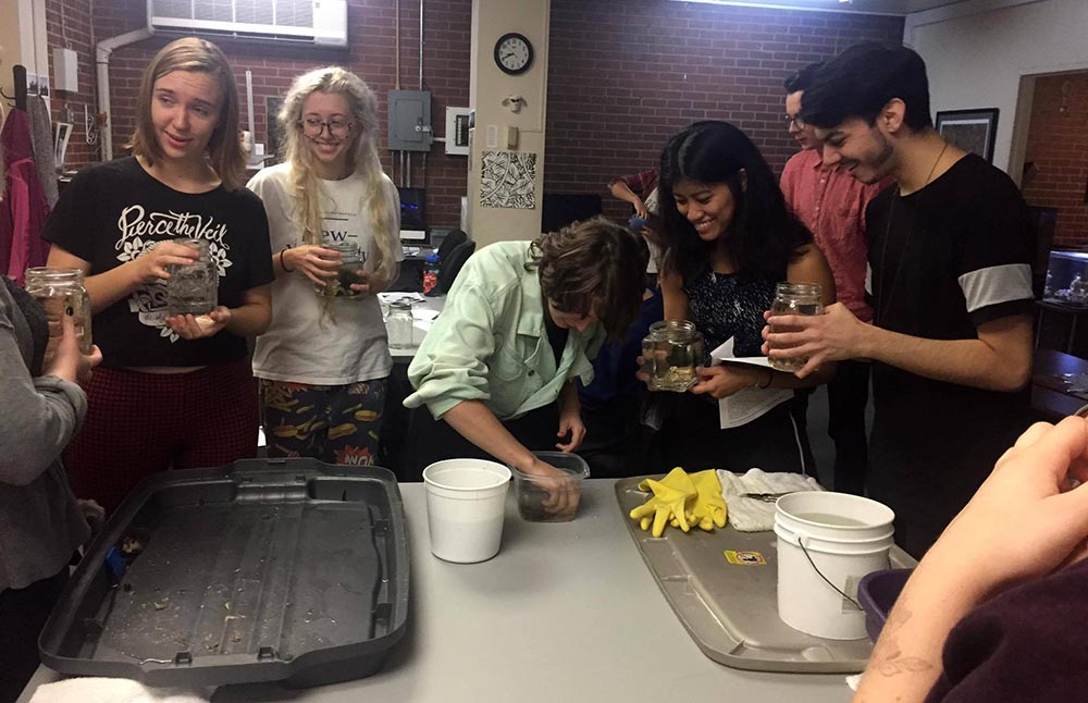 These Pratt students' excitement is undeniable as they assemble their anemone jars.
