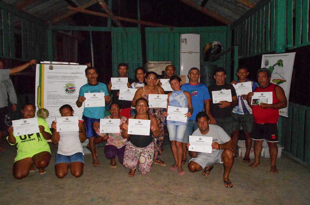 Some of the participants of the trainings proudly display their certificates after completing the workshop.