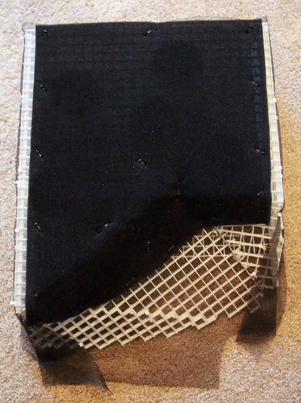 The false bottom constructed of an eggcrate lighting diffuser, window screen, and thin layers of filter foam, allows water to flow freely underneath to filtration systems and overflows.