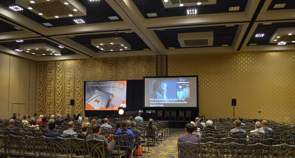 """MACNA 2018's speaker halls were nothing less than spacious, with seating capacity for several hundred attendees if needed. Here, Dr. Rhyne shares a recurring theme among several presentations this year - """"Data and transparency are critical for the long term sustainability and survival of the aquarium trade."""""""