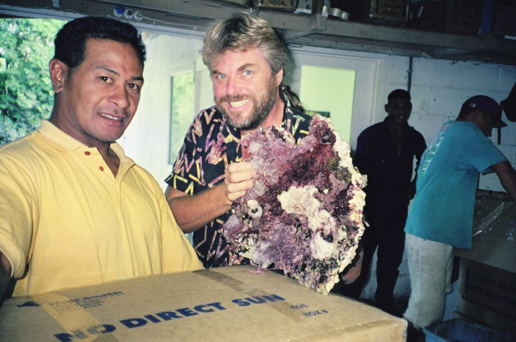 Walt Smith (right) and Hafaka (left) showing off a piece of live rock at the Tonga station in 1991.
