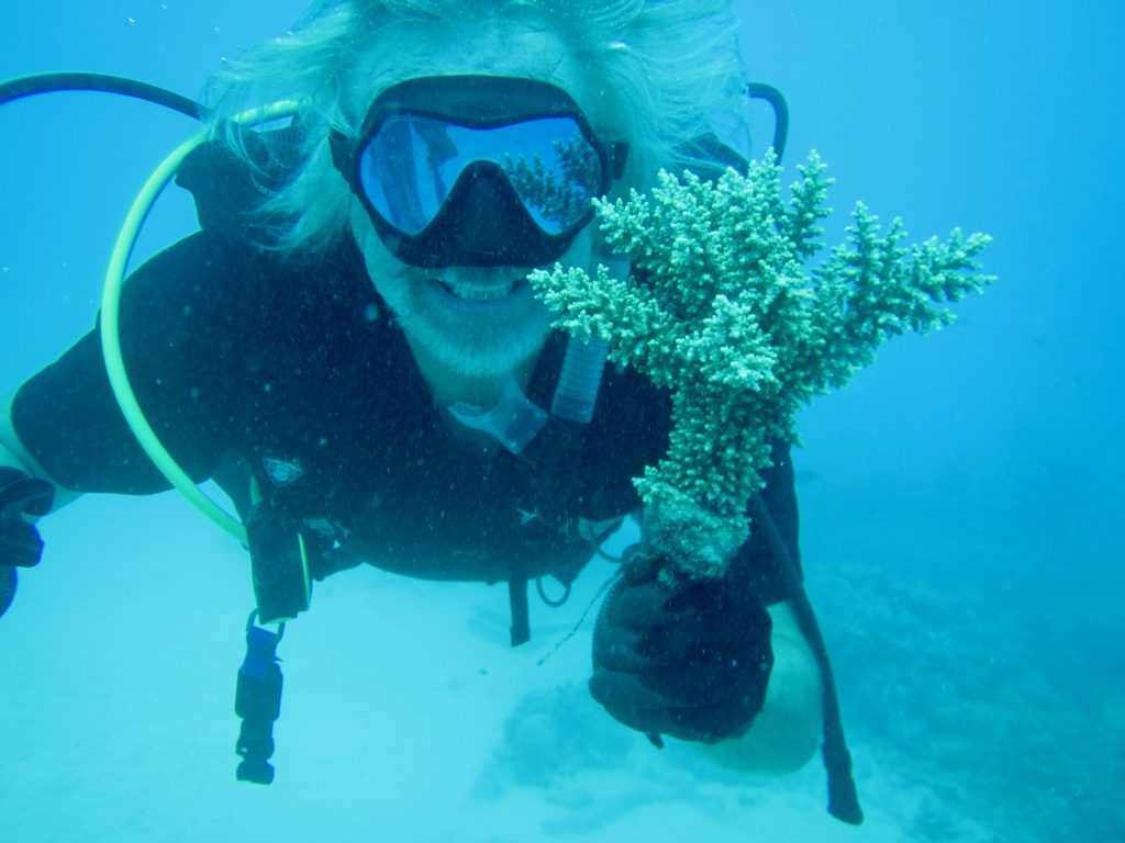 Walt Smith, at home underwater working with a Fijian Acropora.