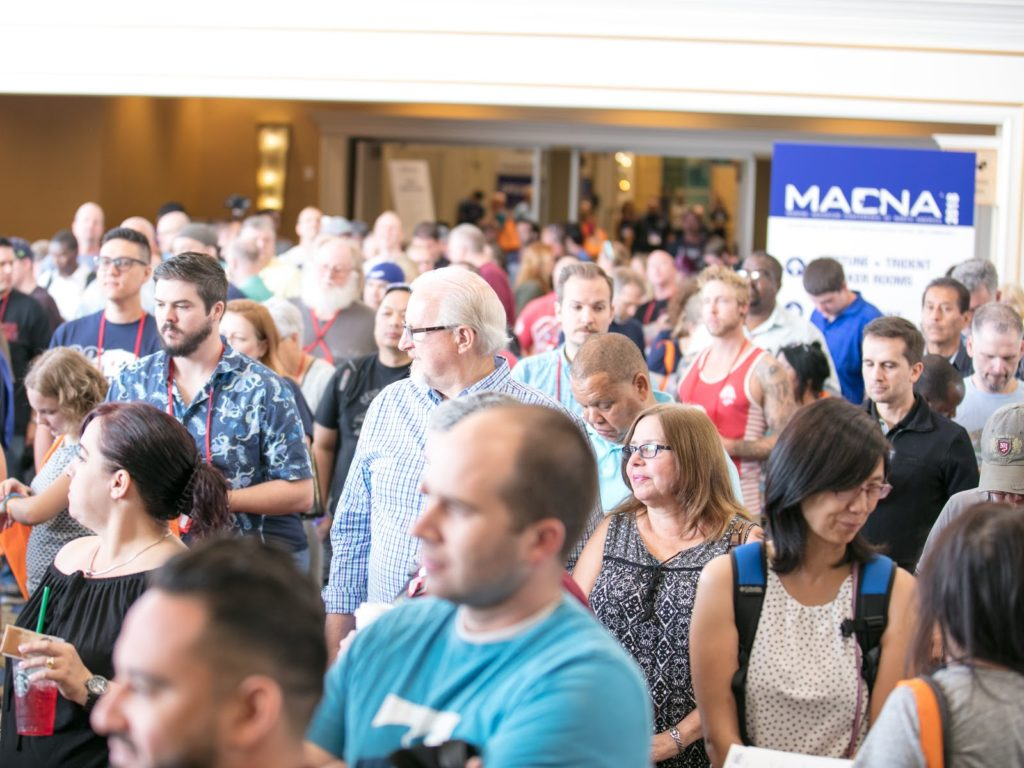Hundreds gathered to await the opening of the MACNA 2018 exhibit floor on Friday morning to the general public.