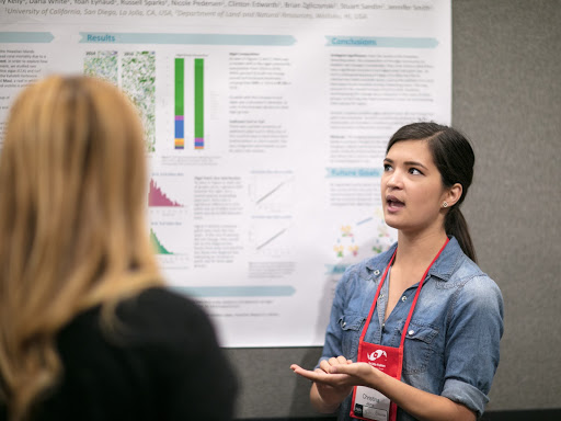 Dozens of individuals, like Christina (pictured) prepared and presented their scientific posters on various marine topics to attendees on the exhibit floor on Friday and Saturday.