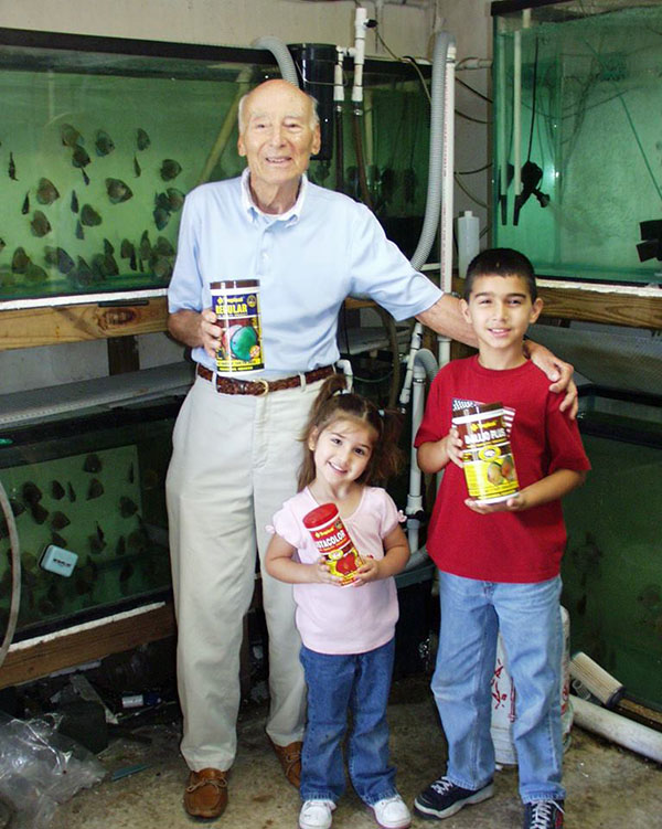 "Jack Wattley, affectionately known by the children in his life as ""Jungle Jack"", posing here with the children of business partner Gabriel Posada."
