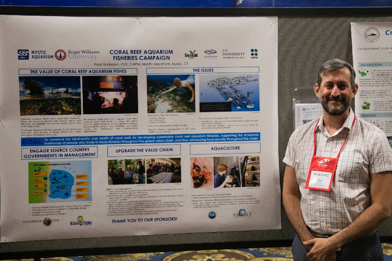 "Dr. Paul Anderson, Mystic Aquarium, presenting the ""Coral Reef Aquarium Fisheries Campaign"" the at the 2018 poster session."