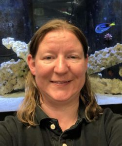 Colchester Pet's Jen Lowy, with Tango the captive-bred Pacific Blue Tang, enjoying life in one of the shop's captive-bred only display aquaria.