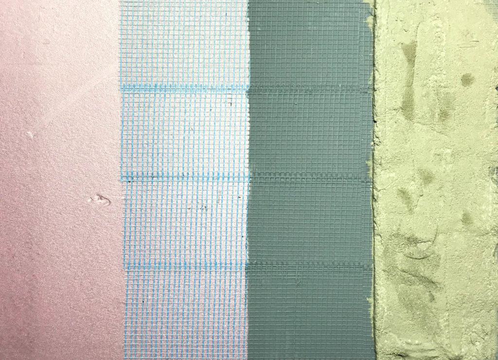 Basin construction layers, from left: pink extruded polystyrene foam, adhesive fiberglass tape, latex masonry waterproofer, surace bonding cement.