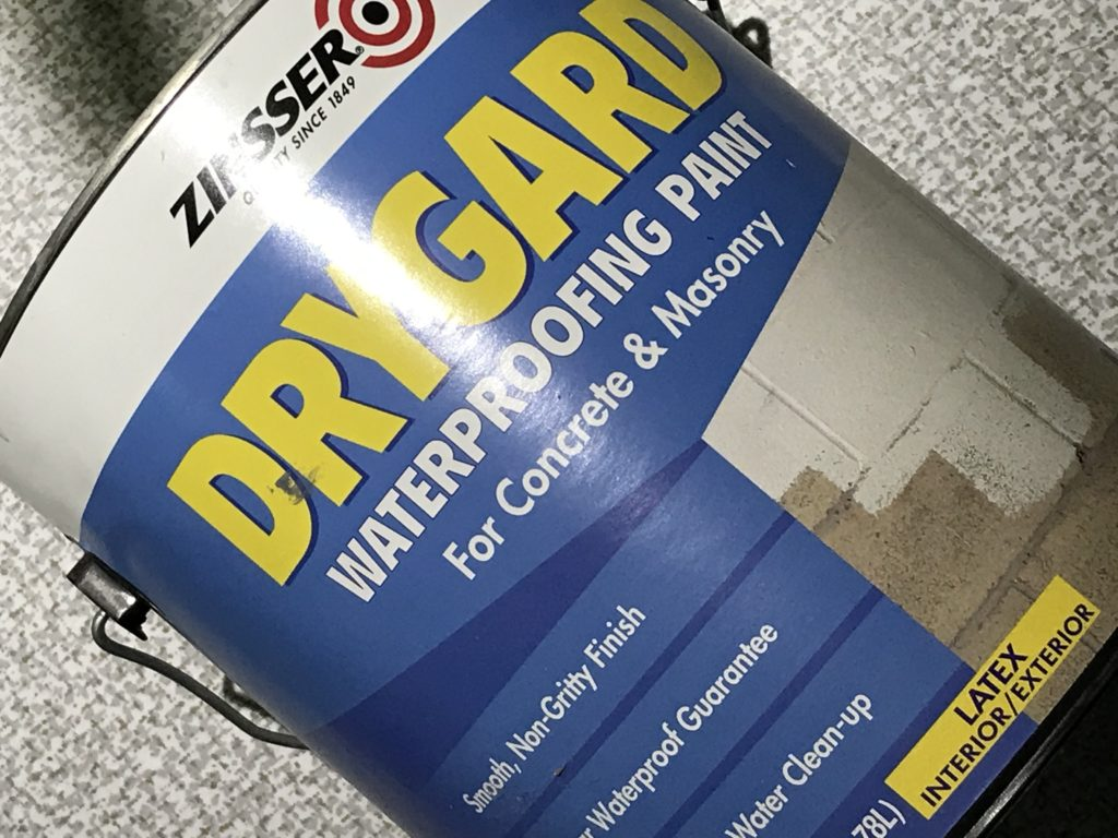 One-gallon (3.8 liter) can of Zinsser® DRYGARD™. This DRYGARD™ formulation was selected among a few different options as a waterproofer paint with added mold or mildew inhibitors.