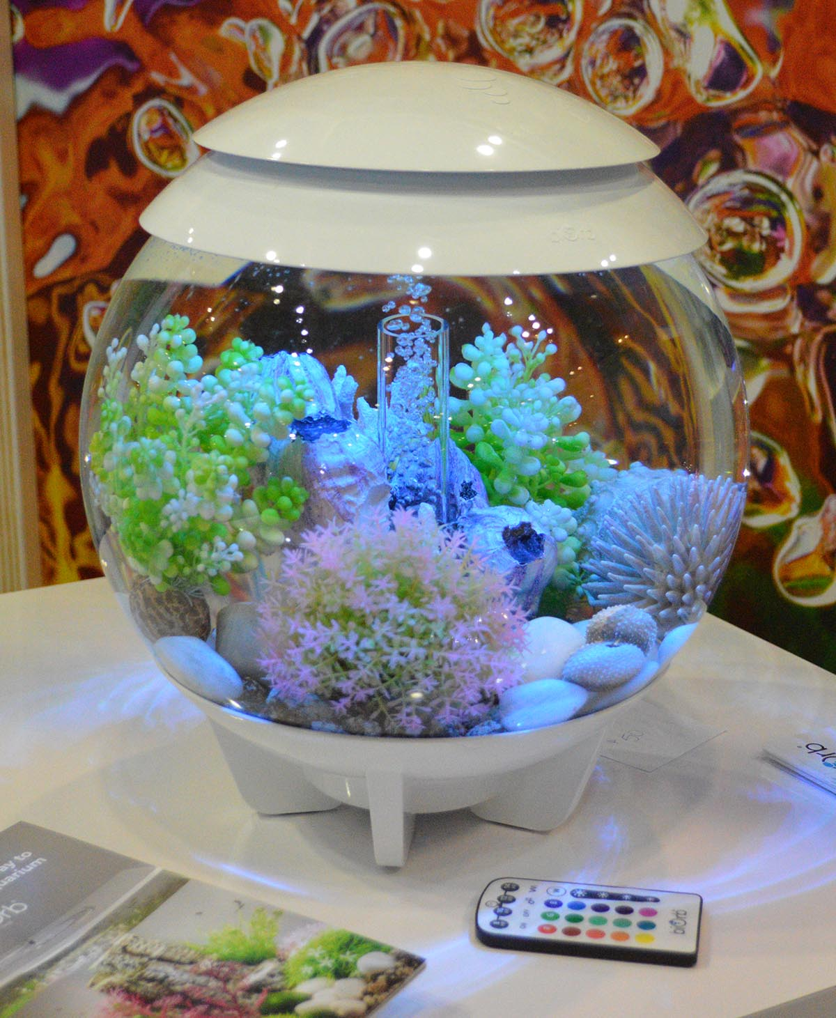 This biOrb HALO also shares a marine theme; one could argue that while such aquariums are not well suited for reef tank use (e.g. built-in lighting might not be sufficient), in the right hands a small aquarium like this might make the ideal home for a small herd of Dwarf Seahorses (Hippocampus zosterae), one of the few fish that may actually do best in a smaller, contained space (with appropriate live feeds and routine husbandry).