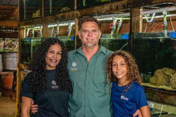 The 2019 Aquarist Of The Year, Tom Bowling, with wife Tatiana and daughter Maya, on location at Biota Marine Life Nursery in Palau.