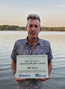 Tal Sweet with the 2020 Aquarist of the Year Award Plaque, on location in MIchigan.