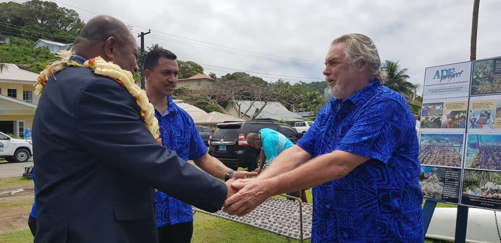 Forestry Minister Naiquamu (left) and Permanent Secretary of Fisheries Pene N. Baleinabuli (center) congratulate Walt Smith (right) of the A.D.E. Project, which will execute the plan to plant out one million new maricultured corals onto Fiji's reefs.