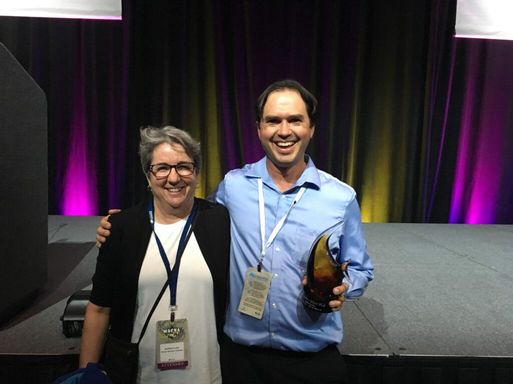Kathy Leahy congratulates Dr. Andrew Rhyne on his 2017 MASNA Award recognition.