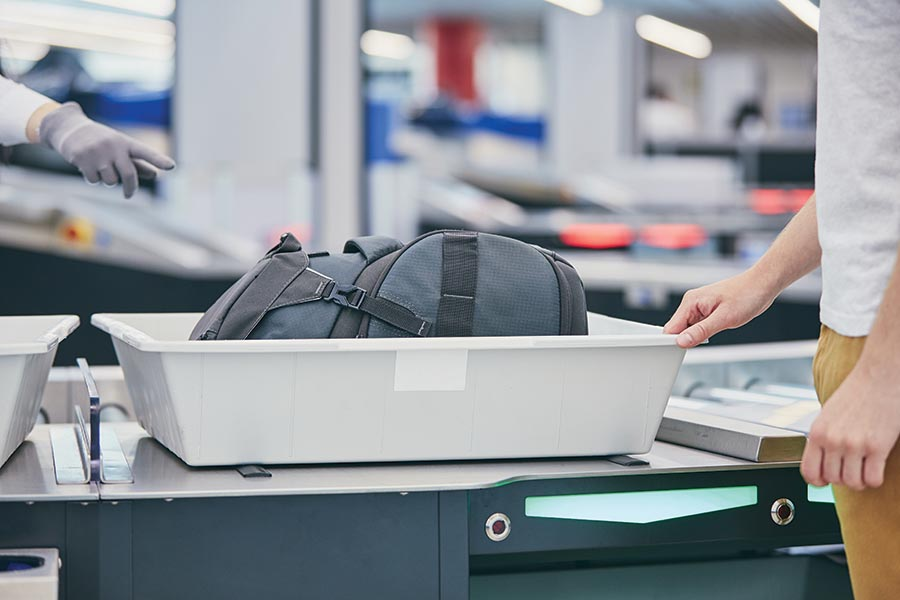 For air travel, TSA will screen any fish-transport containers along with all other carry-on baggage. Photo: Jaromir Chalabala/Shutterstock